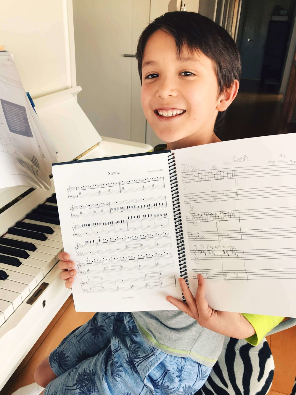 Sage wrote his own piece (on the right) and I helped him see what it looks like on real music (left!).