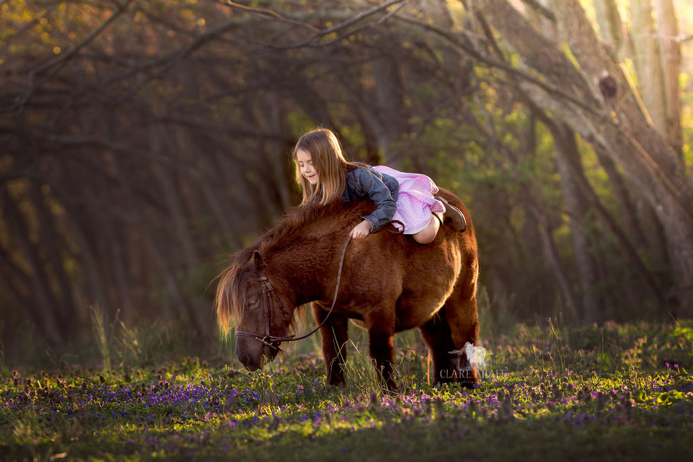 Veterinarian Dr. Ahalt's daughter with her pony on their farm in Frederick MD.
