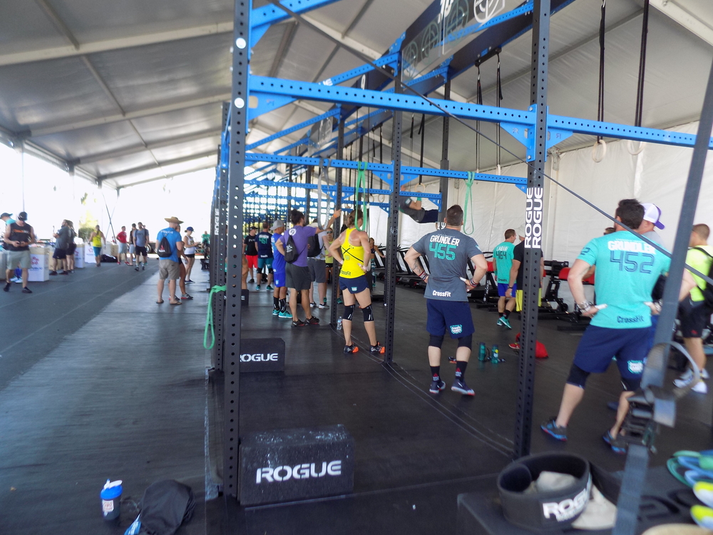 Familiar faces:   That's me in the back, doing a muscle up. My coach is in the purple shirt.   In the foreground is Bill Grundler (452) and his brother (455).