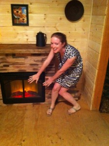 Warming up by the faux fireplace!