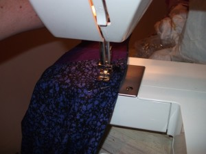 Taking in and hemming!