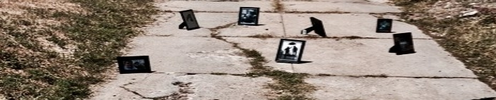 portraits on a sidewalk