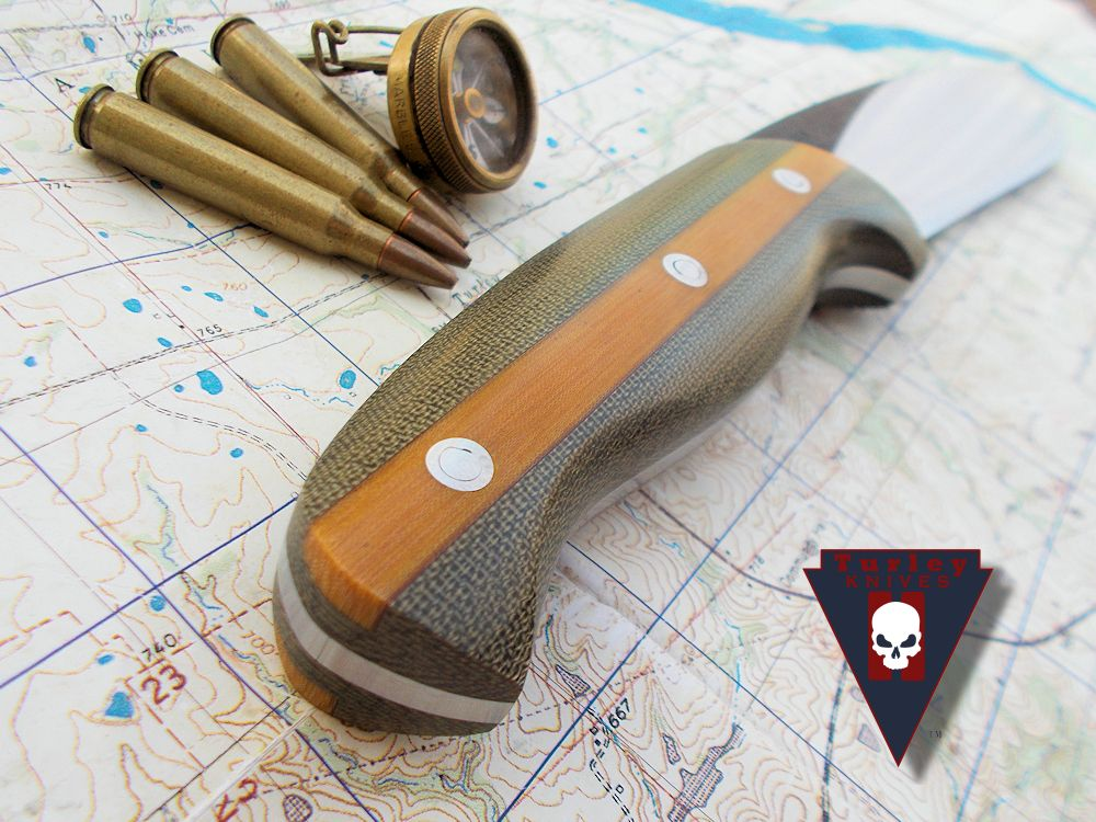 This knife has OD green micarta scales with a Natural linen micarta Fleetside option.