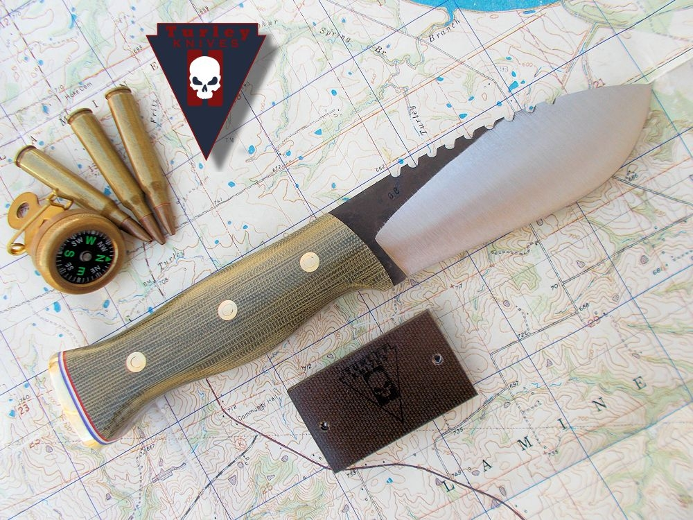 M13 with near full height grind, saw teeth, o.d. canvas micarta scales, r-w-b pommel spacer (not standard, available on request) , brass pommel plate, brass loveless bolts