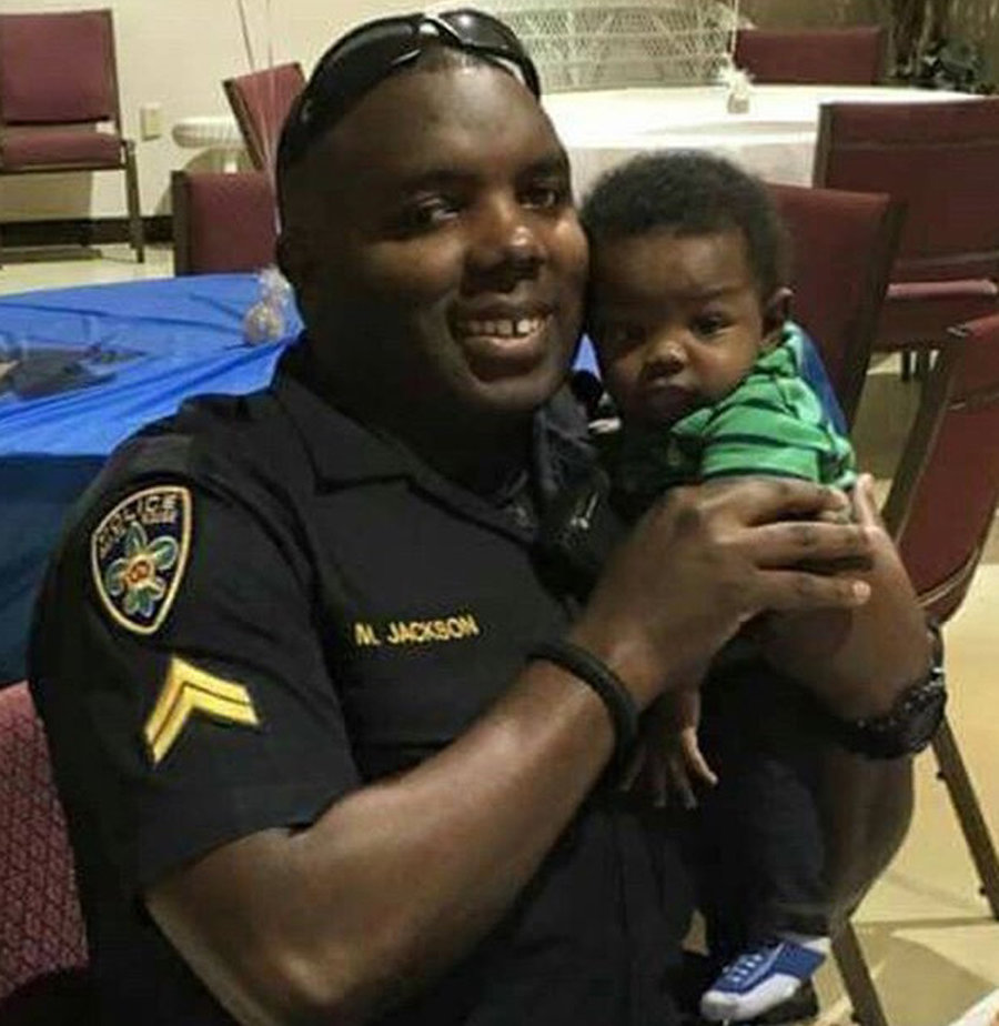 Officer Montrell Jackson and his newborn son.