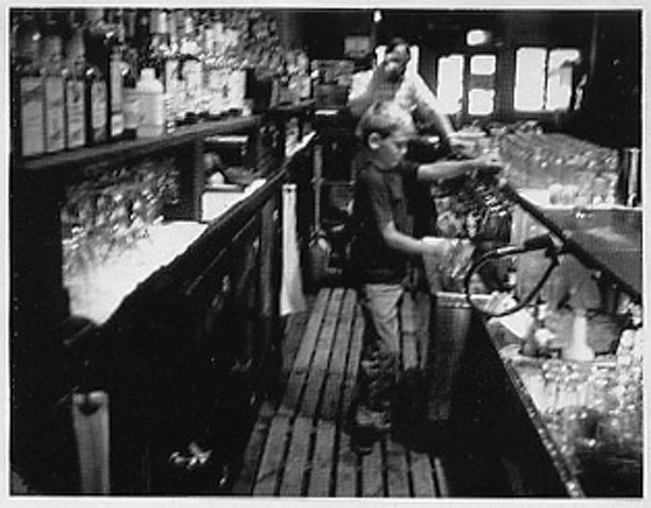 Danny as a boy, working in his father's bar