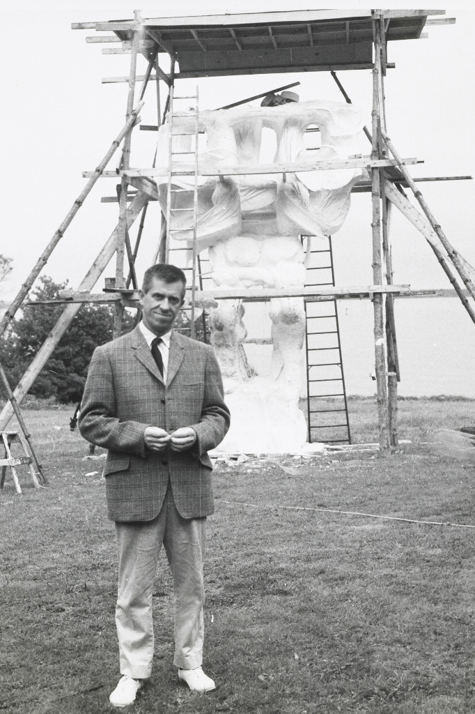 The sculptor with CITY TOTEM, a 17 foot high sculpture in its plaster state, before being cast in bronze. Lincolnville, Maine.