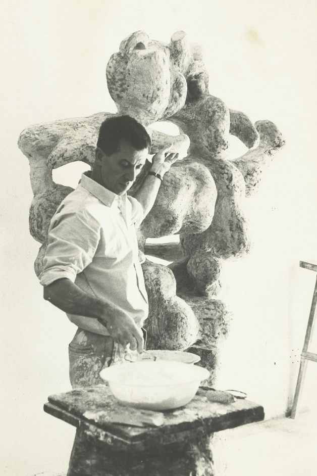 The sculptor working on THE CREATION, in its plaster state, before being cast in bronze. Collection of The Portland Museum of Art, Portland, Maine.