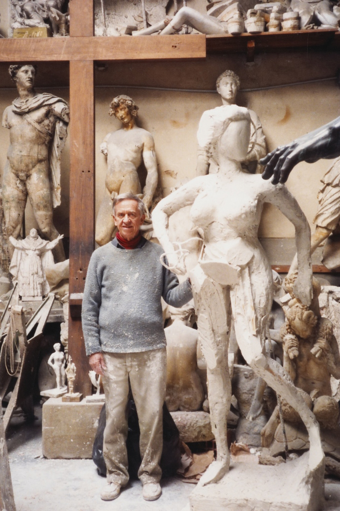 The sculptor working on THE HARVESTING, in The Marinelli Foundry, Firenze, Italy,  1990.