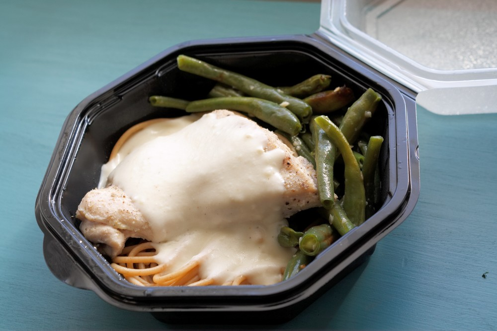 Poached lemon pepper chicken on whole wheat pasta with a lemon grass cream sauce and side of garlic-baked organic green beans.  One serving: 29g protein, 21g fat, 35g carbs