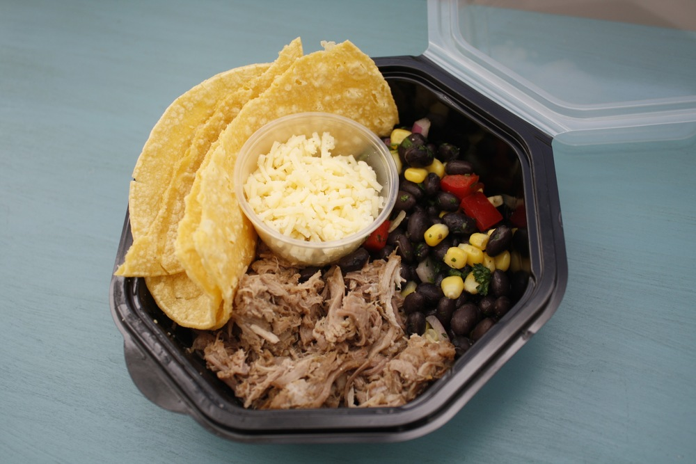 Pork Carnitas with Black Bean Salad and Corn Tortillas One Serving: 47g protein, 34g fat, 53g carbs