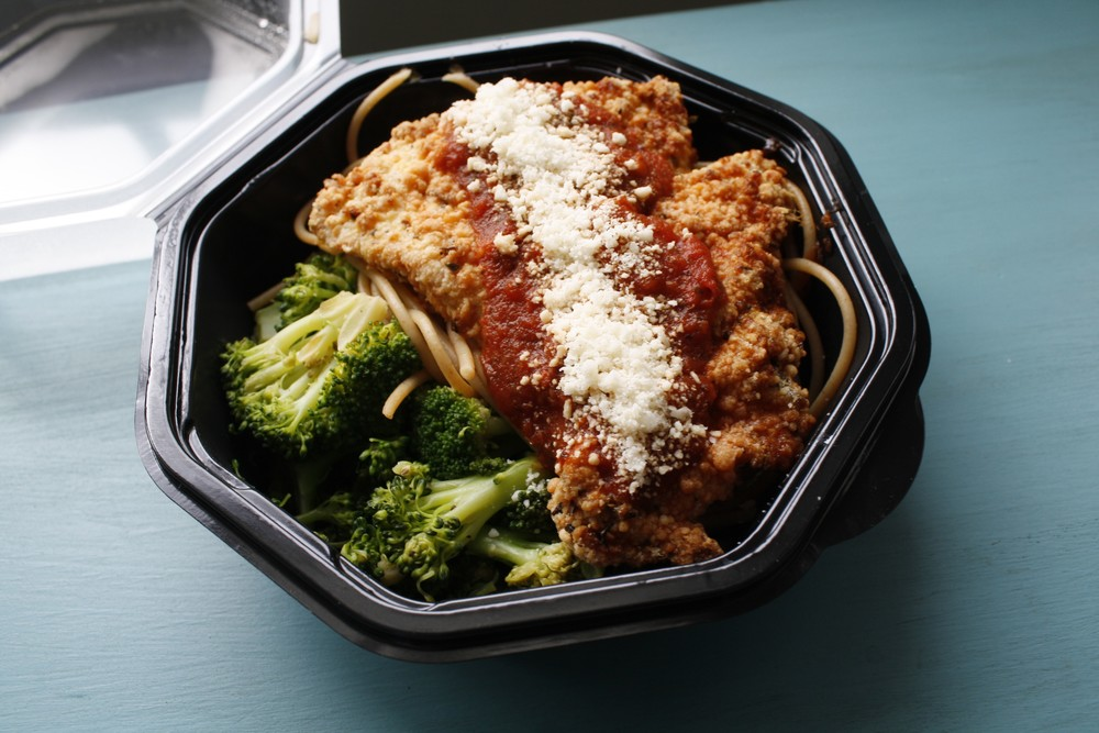 Parmesan Crusted Chicken Breast over Whole Wheat Pasta, topped with Marinara and served with Sauteed Broccoli One Serving: 36g protein, 56g carbs, 14g fat