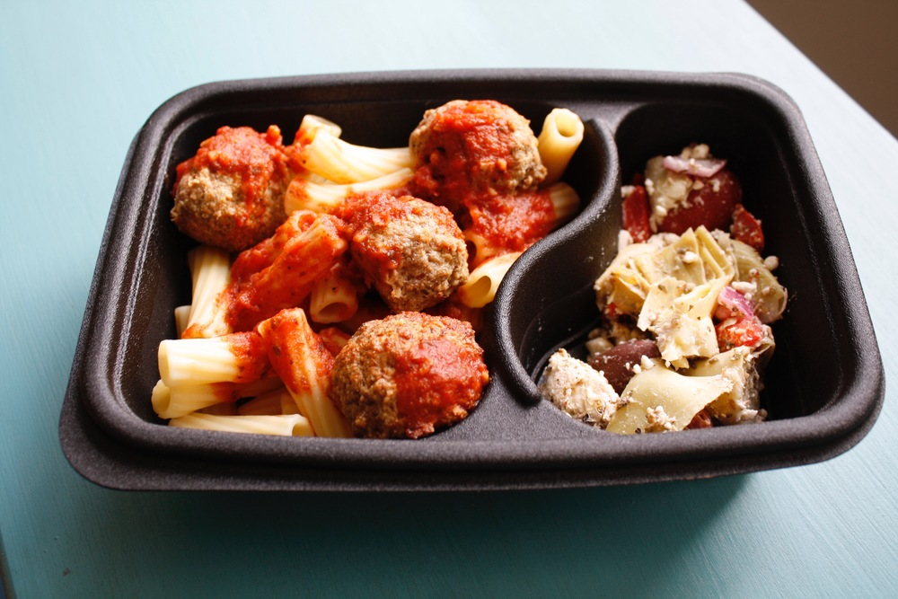 Bison meatballs over organic rigatoni, with garlic marinara sauce and a Greek artichoke side salad  One serving: 43g protein, 60g carbs, 18g fat (572cal)