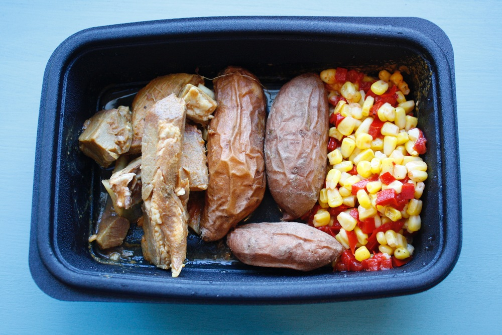 BBQ pork tips with sauteed onions, fingerling sweet potatoes, sauteed corn, and red peppers One serving: 28g protein, 65g carbs, 16g fat (507cal)