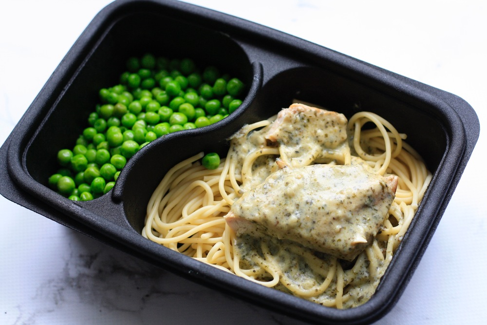 Chicken and Basil Pesto Ingredients: Local chicken breast, organic pasta, organic peas, butter, milk, flour, organic basil, organic pine nuts, garlic, salt, pepper, extra virgin olive oil One serving (standard): 33g protein, 62g carbs, 19g fat (553 cal).