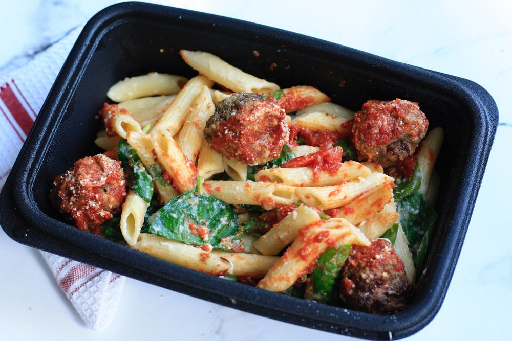 Garlic Parmesan Pasta with Bison Meatballs Ingredients: Local bison, organic penne, organic spinach, peas, grape tomatoes, butter, milk, parmesan, garlic, marinara, bread crumbs, eggs, red pepper, basil, oregano One serving: 31g protein, 55g carbs, 11g fat (450cal)