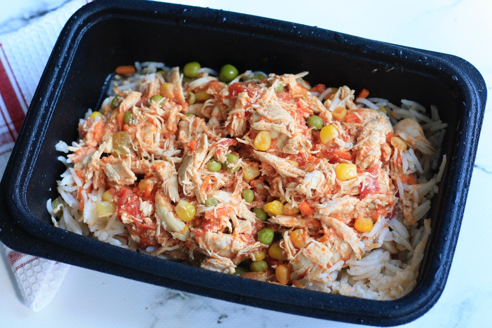 Chicken and Vegetable Stew Ingredients: Local organic chicken breast, organic tomatoes, organic peas, corn, chicken stock, celery, organic basmati rice, salt, pepper. One serving: 43g protein, 57g carbs, 17g fat (563cal)