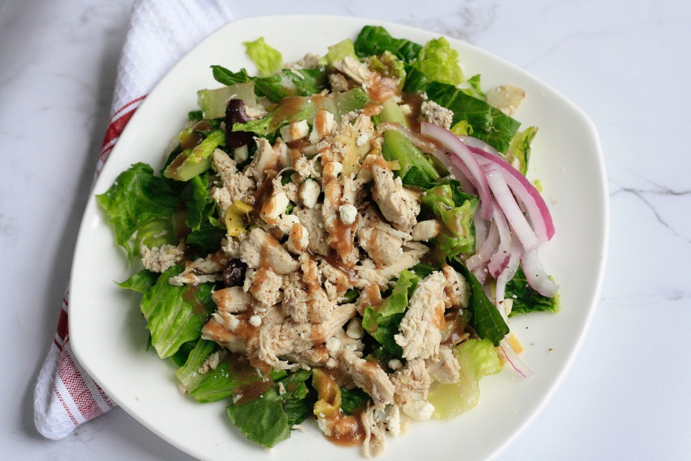 Daniel's Greek Chicken Salad Ingredients: Local chicken breast, romaine, balsamic vinaigrette (olive oil, balsamic, salt, pepper, basil, oregano, garlic powder), organic red onion, feta, organic Kalamata olives, organic pepperoncini, artichoke heart