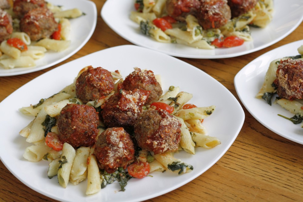 Daniel's Local Bison Meatballs over Garlic Parmesan Penne Ingredients: Local bison, organic penne, organic spinach, peas, grape tomatoes, butter, milk, parmesan, garlic, marinara, bread crumbs, eggs, red pepper, basil, oregano One serving: 31g protein, 55g carbs, 11g fat (450cal)