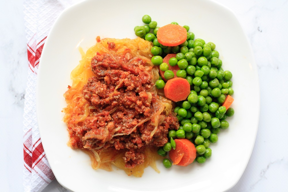 Bison Bolognese over Spaghetti Squash with Peas Ingredients: Local bison, marinara sauce, spaghetti squash, peas, carrots, olive oil, salt, pepper One serving: 27g protein, 15g carbs, 8g fat, 301cal