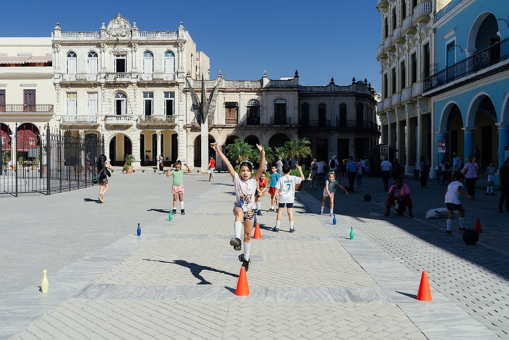 School children have gym class in the Plaza Vieja in Havana Cuba