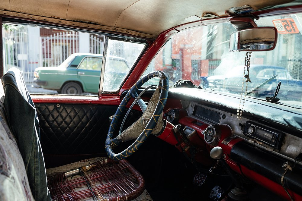 I loved looking into the old cars in Cuba to see how the maintain them. Here a dilapidated lawn-chair is an upgrade to the decaying upholstery.