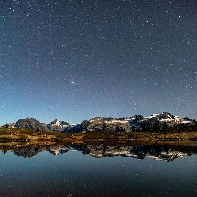 A classic contemplative view. Mamquam Mountain reflected in Elfin Lakes and under a vast starry sky.