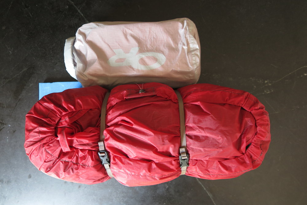 Left Pannier - Contains a dry bag wiith first aid kit, gear repair stuff, and bear bangers. And the tent.