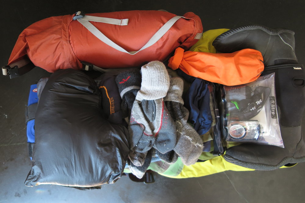 Big Dry Bag - This massive dry bag contains a thermarest, sleeping bag, clothes, towel, personal gear, rubber boots, crocs, electronics bag, maps, etc..
