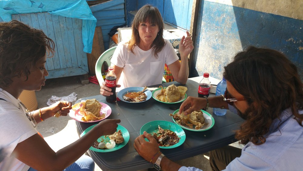 Linda Nelson of IndieRights & fellow filmmaker and localsat the festival sampling the local cuisine of Ghana in the heart of the city, Accra - IndieRights is a power house VOD distribution company based in the City of Angels (LA) - Picture taken at Old Kingsway in James Town, Accra, Ghana