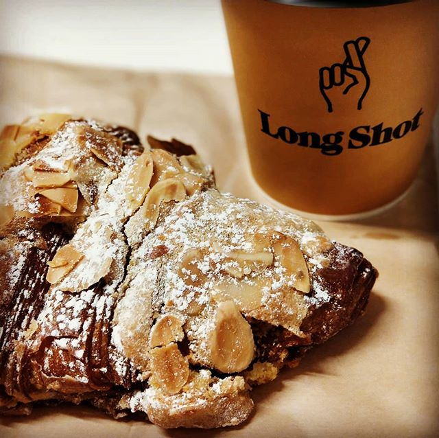 My #morningelixir from #longshotcafe and an #almondcroissant this fine #Friday  #happyfriday everyone!