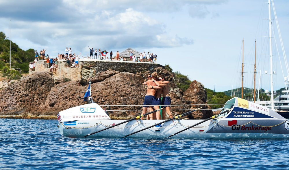 The Row For James team crossing the finish line