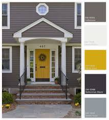 yellow door with gray house.jpeg