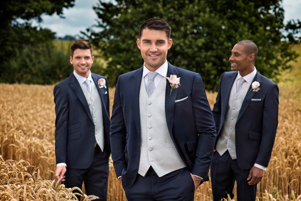 Navy slimfit Tails or lounge suit. Hire package from £140. Purchase from £550.   Hire package includes Jacket, Trousers, waistcoat, shirt, neckwear, handkerchief & accidental insurance.