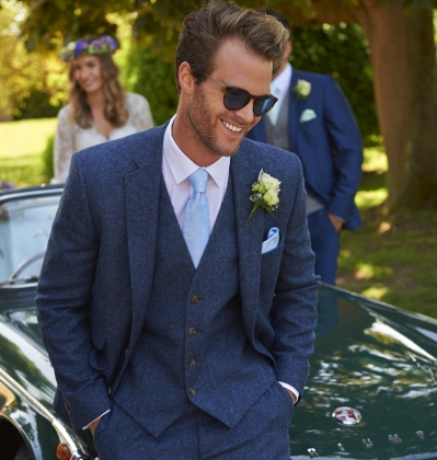 Blue-Grey slimfit Tweed lounge suit. Hire package from £200. Available to purchase from £499