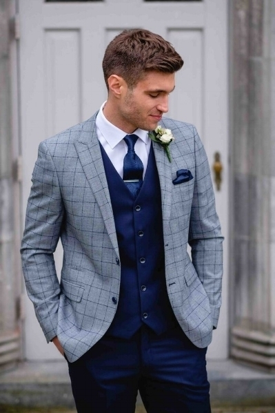 Light Grey & Navy check lightweight Suit. Available to mix and match with Navy trousers. Hire Package From £140 Available to buy £350