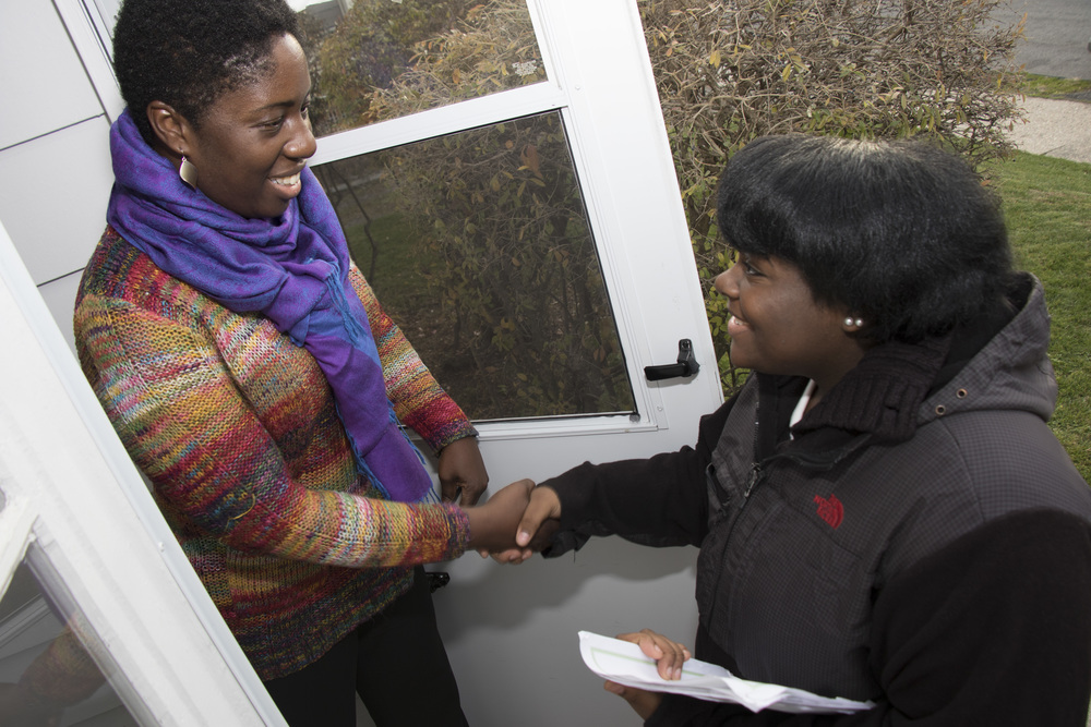 Nalaisha and other youth participants conducted door to door outreach to residents.