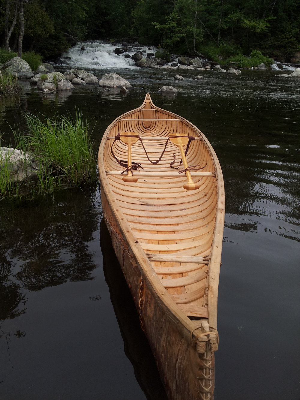 Hand crafted Birch Bark Canoe with tump line carry system.
