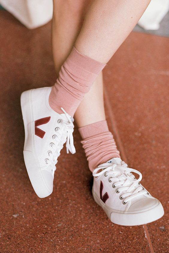 Veja - Based in France, Veja shoes and accessories are made of organic cotton, vegetable tanned leather, and wild rubber from the Amazon. We love them because of their timeless and minimalist styles.