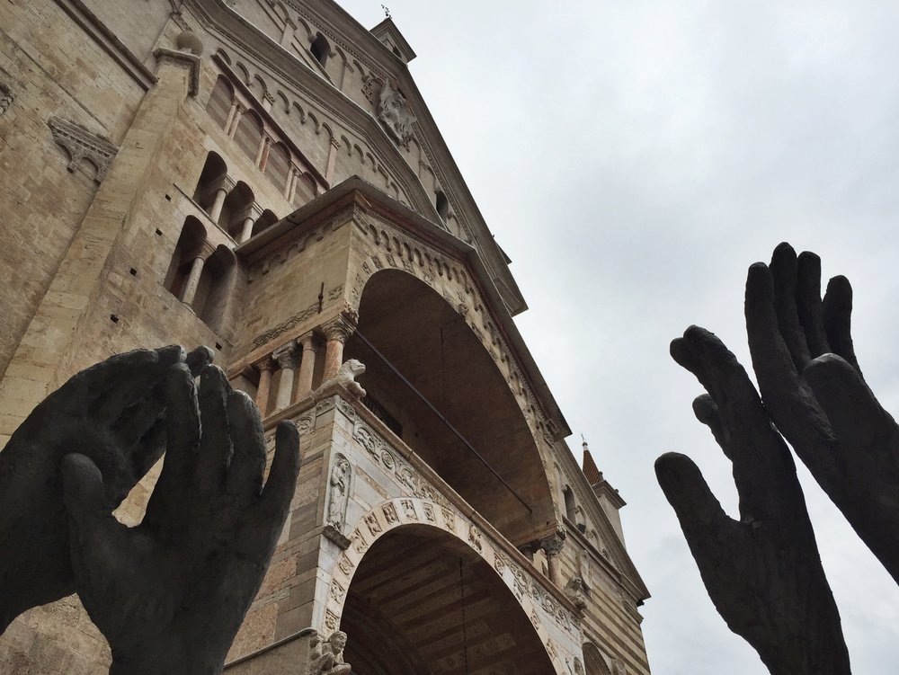 Sculpted hands in front of a church in Venezia, Italy