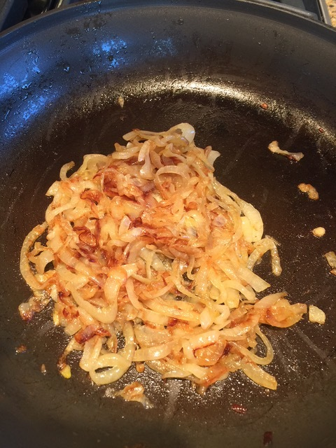 Caramelized onion are deep golden with some slices very dark brown.