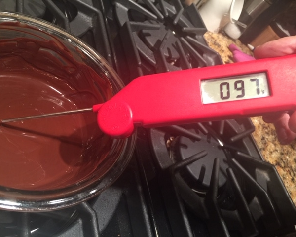 Make sure the chocolate is no more than 100 degrees or it will melt the butter