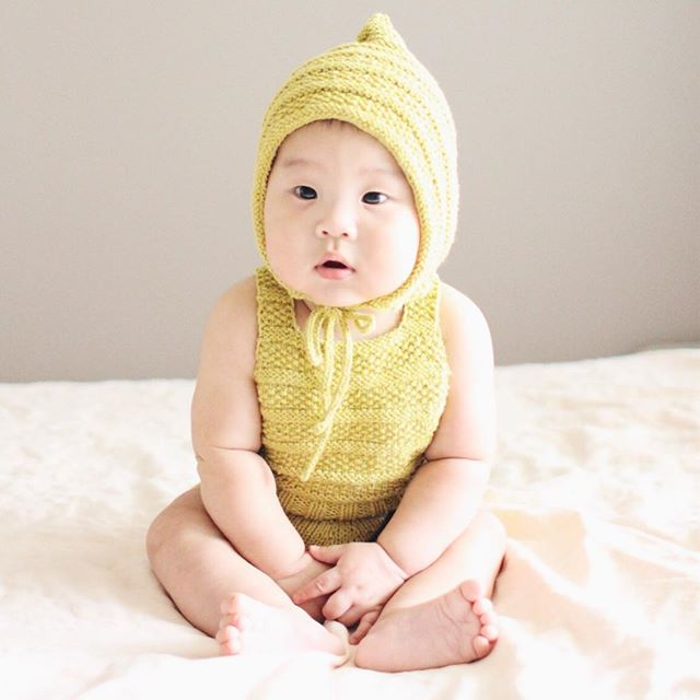 Has anyone made the #bonsaisunsuit in wool? I'm knitting right now in @purlsoho beautiful merino bloom which is a lovely cashmere merino blend yarn. This would be a perfect baby gift knit up in that yarn!  This sweet version by @atelier_by_renee