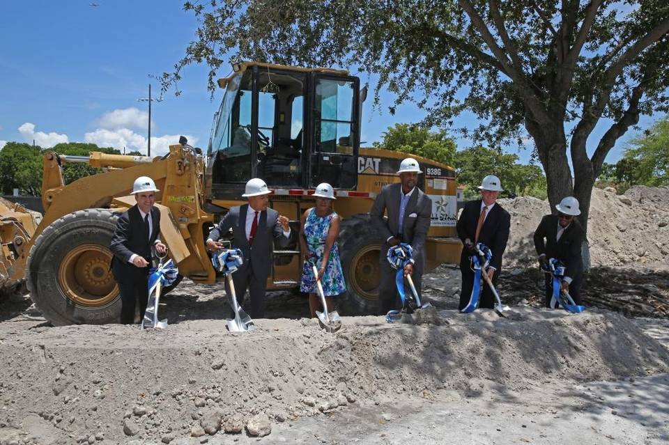 Officials break ground for an affordable housing project in Overtown in 2015. From left: Matthew Rieger, President of the Housing Trust Group; Miami Comm. Keon Hardemon; Miami-Dade Comm. Audrey Edmonson; Alonzo Mourning; Randy Rieger, and Clarence Woods, Executive Director of the Miami Community Redevelopment Agency. Photo credit: WALTER MICHOT (Miami Herald)
