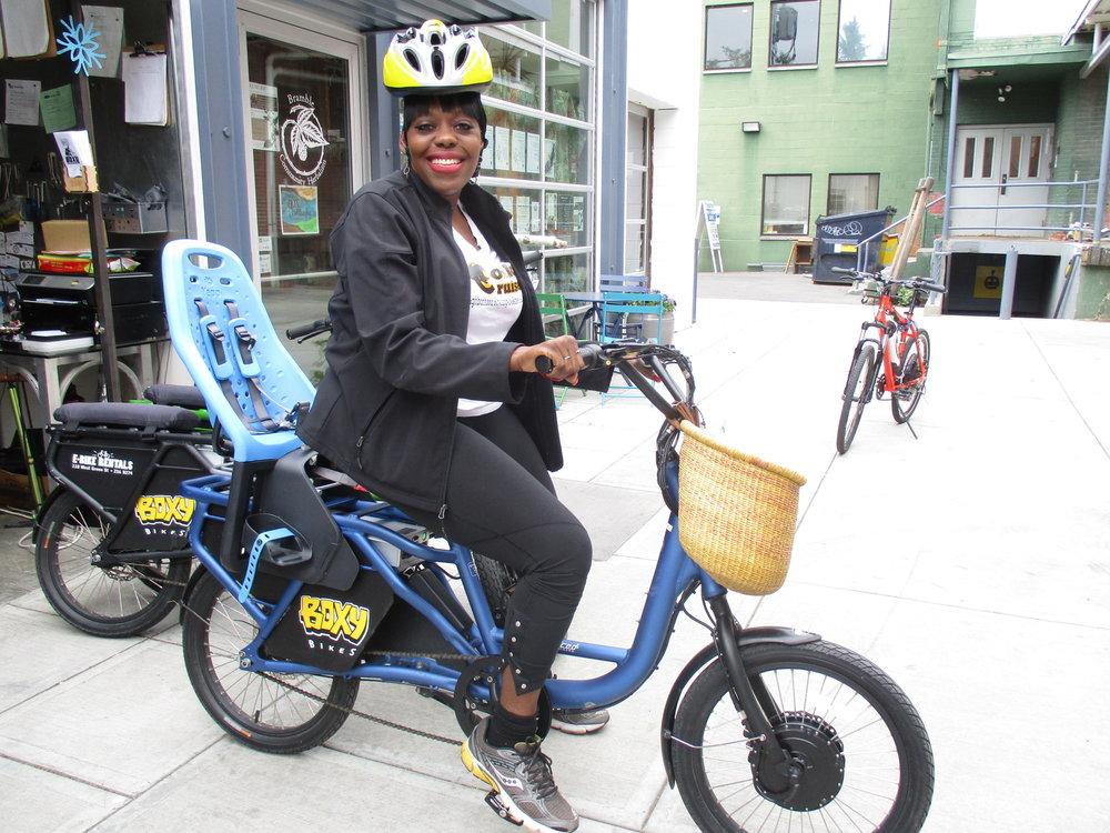 Theresa Bowick from Conkey Cruisers rents a Boxy Bikes e-bike.