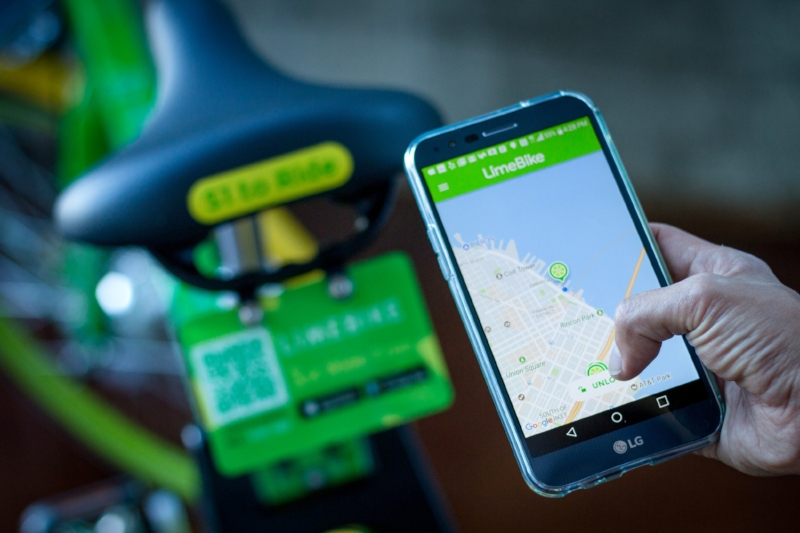 Person looking at LimeBike on phone
