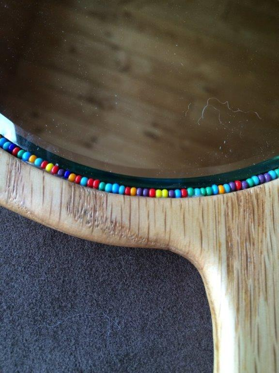 Detail of a beveled, beaded oak mirror by Jack
