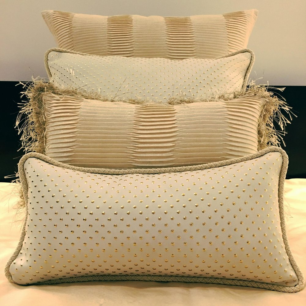 gold pleated and leather dot pillows.jpg