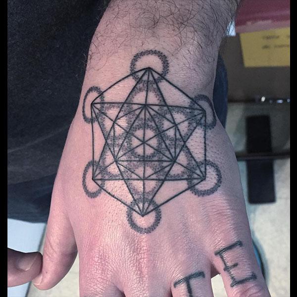 hand-sacred-tattoo.jpg