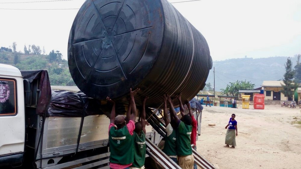 The school's water tank being delivered from Kigali